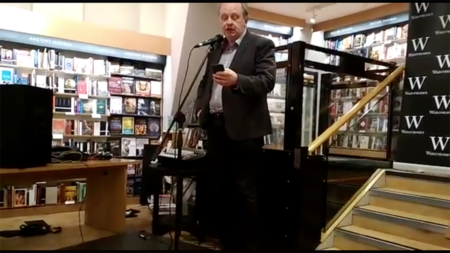 William Gallagher performing poetry at Waterstones Bookstore.