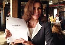 Star Julianna Margolies holding a script for The Good Wife